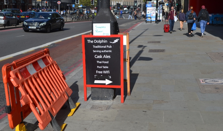 Illegal A board presentation on Euston Road, from The Dolphin public house