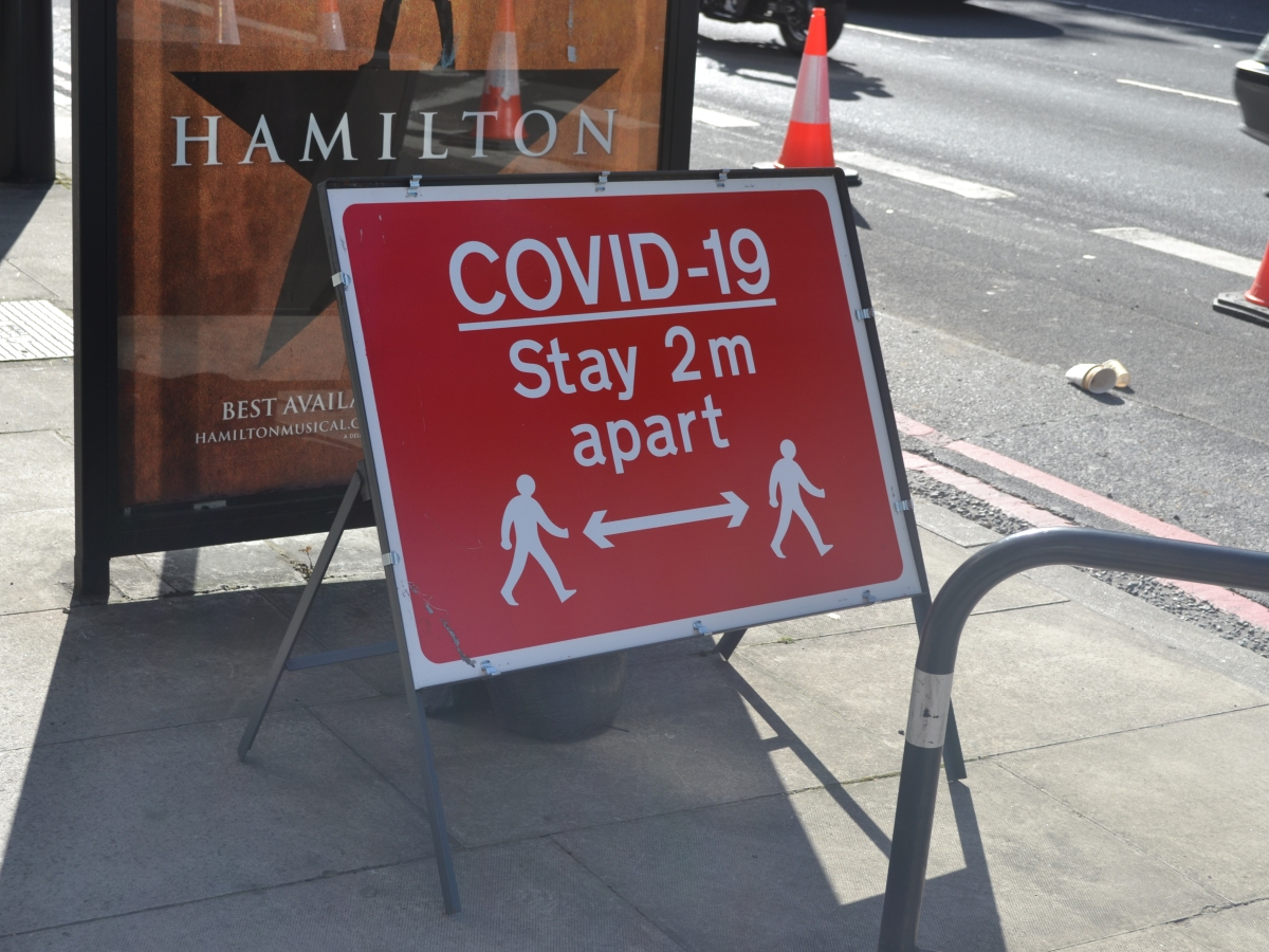 A COVID-19 stay apart roadworks sign on Euston Road