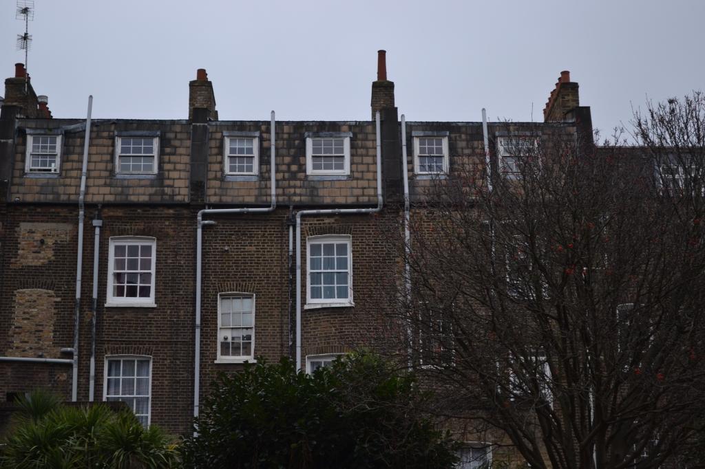 The rear elevation of old Georgian Houses on Swinton Street, in King's Cross