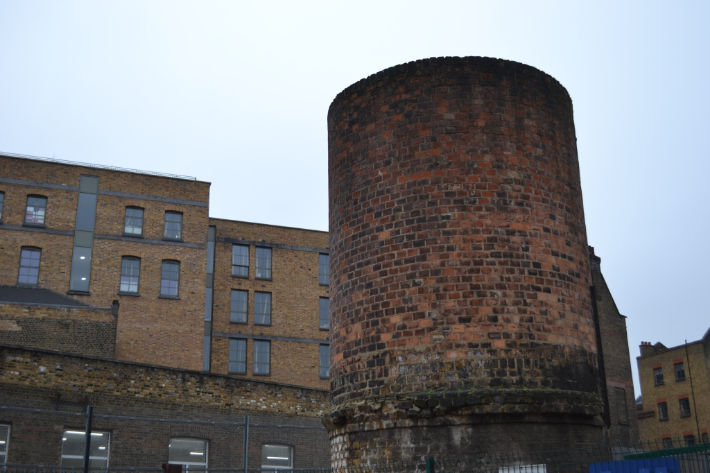 A dilapidated industrial chimney in King's Cross.