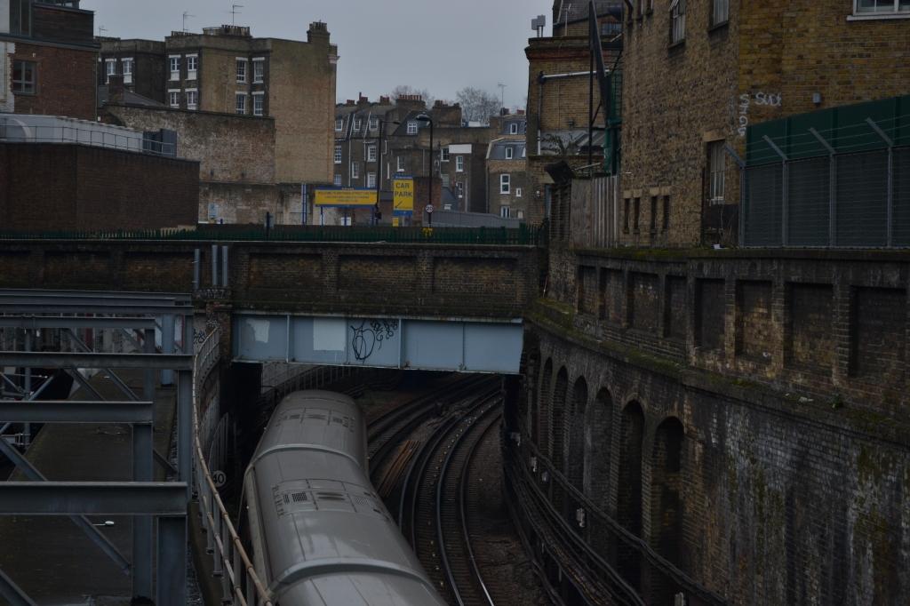 A modern London Underground train goes through the Metropolitan Underground Railway in King's Cross