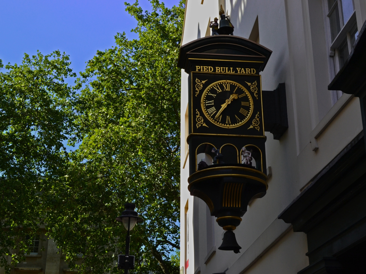 A beautiful wall clock outside Pied Bull Yard, Bloomsbury