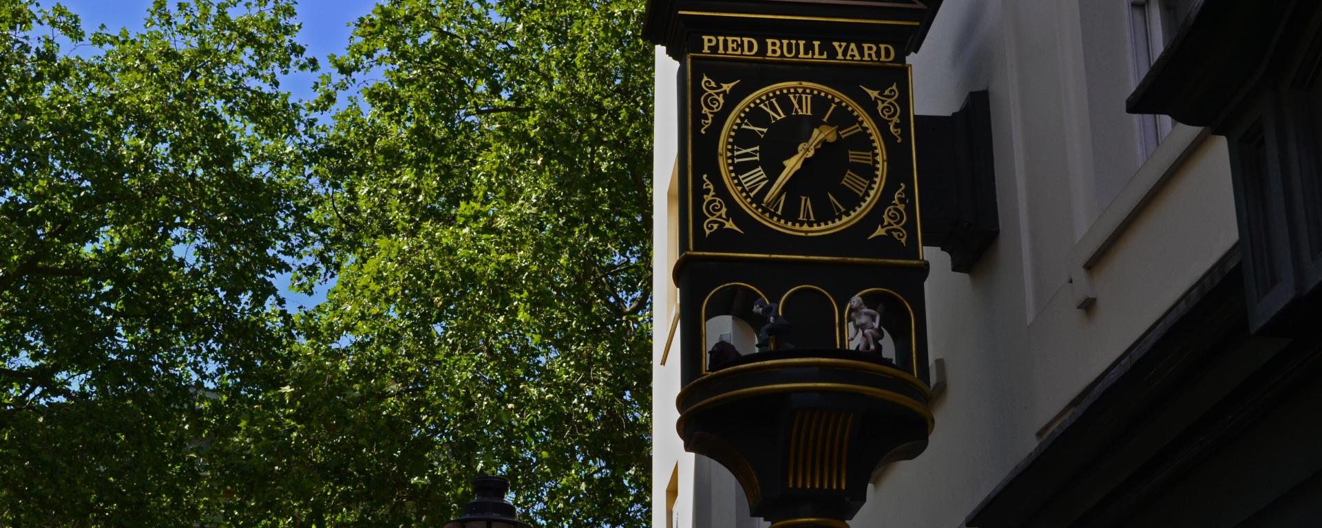 A beautiful wall clock outside Pied Bull Yard, Bloomsbury